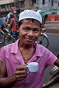 A rickshaw driver drinks tea as he takes a break from a busy day at the Central Train Station in Dhaka, Bangladesh. (From the book What I Eat: Around the World in 80  Diets.)