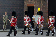 The Grenadier Guards Corps of Drums leaves Victoria Barracks to march to Windsor Castle to perform the Changing of the Guard ceremony on 29th July 2021 in Windsor, United Kingdom. The ceremony, which is also known as Guard Mounting, was reinstated on 22nd July for the first time since the beginning of the Covid-19 pandemic in March 2020.
