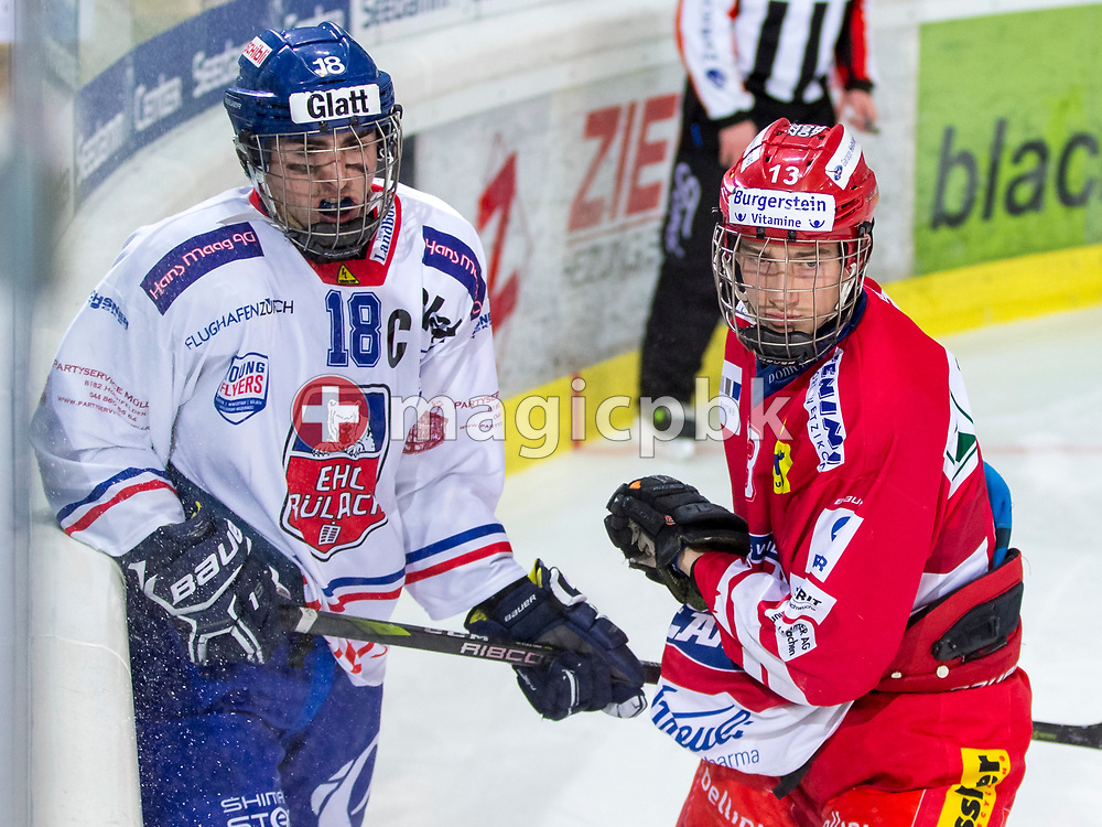 EHC Buelach forward Mike Grob (L) and Rapperswil-Jona Lakers forward Jonas Graetzer are pictured during the third Elite B 1/4 final Playoff ice hockey game between Rapperswil-Jona Lakers and EHC Buelach in Rapperswil, Switzerland, Sunday, Feb. 18, 2018. (Photo by Patrick B. Kraemer / MAGICPBK)