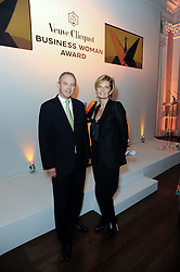 SABINA BELLI and GRAHAM BOYES MD of Veuve Clicquot at the presentation of the Veuve Clicquot Business Woman Award 2010 held at the Institute of Contemporary Arts, 12 Carlton House Terrace, London on 23rd March 2010.  The winner was Laura Tenison - Founder and Managing Director of JoJo Maman Bebe.