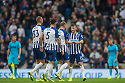Pascal Gross (Brighton) with Adam Webster (Brighton), Lewis Dunk (Capt) (Brighton) & Dan Burn (Brighton) in a queue in front of him at the final whistle during the Premier League match between Brighton and Hove Albion and Tottenham Hotspur at the American Express Community Stadium, Brighton and Hove, England on 5 October 2019.