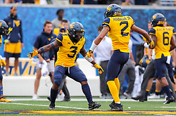 Sep 22, 2018; Morgantown, WV, USA; West Virginia Mountaineers safety Toyous Avery Jr. (3) and West Virginia Mountaineers safety Kenny Robinson Jr. (2) celebrate after stoping Kansas State Wildcats on fourth down during the second quarter at Mountaineer Field at Milan Puskar Stadium. Mandatory Credit: Ben Queen-USA TODAY Sports