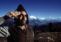 Gurkha L.Cpl Jang Bahadur Thapa seen in his hilltop village of Shakar Pokhari,Nepal. In the background the Himalayan range can be seen with Dhaulagiri and Annapurna.1969. Photographed by Terry Fincher