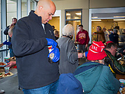27 NOVEMBER 2019 - DES MOINES, IOWA: US Senator CORY BOOKER (D-NJ) brings salt, pepper, and cheese to a table during lunch at Central Iowa Shelter and Services in Des Moines. Sen Booker helped plate up and serve lunch at the shelter. The shelter has about 180 beds and is full almost every night. In January and February, more than 250 people per night come to the shelter, which sets out overflow bedding. Senator Booker is running to be the Democratic nominee for the US Presidency in 2020. Iowa hosts the first selection event of the presidential election season. The Iowa caucuses are February 3, 2020.        PHOTO BY JACK KURTZ