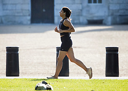 © Licensed to London News Pictures. 02/08/2021. London, UK. A woman jogging in the early morning sunshine on a warm summers day in Westminster, central London. Photo credit: Ben Cawthra/LNP