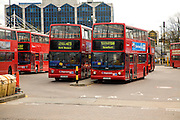Red double decker buses in Stratford bus station terminal, Newham, London