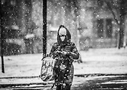 A woman makes her way down Locust Walk during the first major snow storm of the season at the University of Pennsylvania in Philadelphia, Pennsylvania on December 16, 2020.