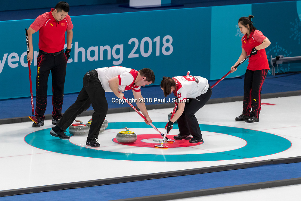 Martin Rios and  Jenny Perret (SUI) vs  Ba Dexin and Wang Rui (CHN) competing in the Mixed Doubles Curling round robin at the Olympic Winter Games PyeongChang 2018