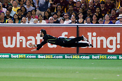 © Licensed to London News Pictures. 26/12/2013. Glenn Maxwell dives to save the ball from going for four during the 2nd T20 international between Australia Vs England at the Melbourne Cricket Ground, Victoria, Australia. Photo credit : Asanka Brendon Ratnayake/LNP