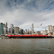 New York skyline panorama seen from Brooklyn with a ship