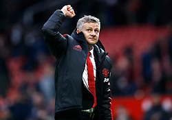 Manchester United's interim manager Ole Gunnar Solskjaer celebrates victory after the Emirates FA Cup, third round match at Old Trafford, Manchester.