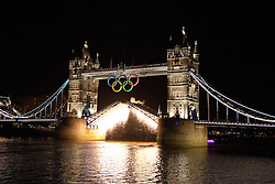 © Licensed to London News Pictures. 25/07/2012. London, UK. Fireworks explode from raised Tower Bridge bascules on 24th July 2012 in a rehearsal event believed to be related to the opening ceremony of the London 2012 Olympic Games. Photo credit : Vickie Flores/LNP