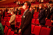 """Audience protected with face masks due Corona restrictions during the ceremony including the awarding of the European Charles Prize  during the 71st Sudeten German meeting at the """"Philharmonie im Gasteig"""" in Munich."""