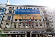 Berlin, Germany - August 31, 2015: A large sign drawing attention to the war in eastern Ukraine is attached to the exterior of the Haus Am Checkpoint Charlie, a private museum in Berlin, Germany.  Checkpoint Charlie was the main crossing point at the Berlin Wall between West Berlin and East Berlin during the Cold War.