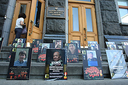 May 23, 2019, Kyiv, Ukraine: The photographs of perished servicemen are lined up on the steps of the Presidential Administration as widows hold a protest action against a referendum on making agreements with Russia over peace in Donbas, Kyiv, capital of Ukraine. (Credit Image: © Ovsyannikova Yulia/Ukrinform via ZUMA Wire)