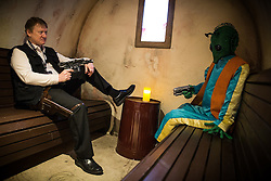 "© Licensed to London News Pictures . 06/12/2015 . Manchester , UK . Han Solo ( Mark Robinson , 48 from Urmston ) about to shoot Greedo FIRST in a bar built as a recreation of the Mos Eisley cantina . I don't like him either . Fans attend Star Wars exhibition "" For the Love of the Force "" at Bowlers Exhibition Centre in Manchester . Photo credit : Joel Goodman/LNP"