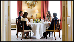Prime Minister David Cameron and his wife Samantha have lunch in The White Room of Number 10 Downing Street with The French President Nicolas Sarkozy and his wife Carla Bruni-Sarkozy, Friday June 18, 2010. Photo By Andrew Parsons / i-Images.<br /> File photo - French ex-President Nicolas Sarkozy has been detained for questioning over alleged influence peddling.<br /> Mr Sarkozy is being held at Nanterre, near Paris, in an unprecedented step against a former president. Photo filed Tuesday July 01 2014.