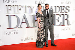 Jamie Dornan and Dakota Johnson (wearing Alexander McQueen) attending the UK premiere of 50 Shades Darker, at the Odeon cinema in Leicester Square, London. Picture date: Thursday February 9th, 2017. Photo credit should read: Matt Crossick/ EMPICS Entertainment.