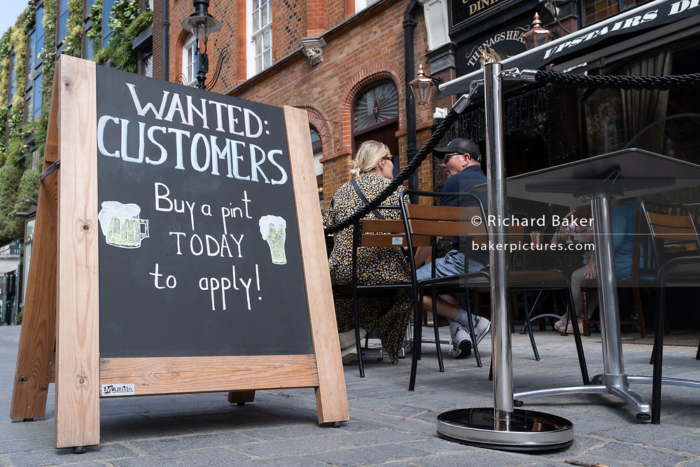A sign outside a bar wants customers to return and help support their business in Covent Garden, on 20th August 2020, in London, England