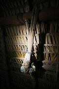 Traditional stone axes for cutting trees hang inside Surui home<br /><br />An Amazonian tribal chief Almir Narayamogo, leader of 1350 Surui Indians in Rondônia, near Cacaol, Brazil, with a $100,000 bounty on his head, is fighting for the survival of his people and their forest, and using the world's modern hi-tech tools; computers, smartphones, Google Earth and digital forestry surveillance. So far their fight has been very effective, leading to a most promising and novel result. In 2013, Almir Narayamogo, led his people to be the first and unique indigenous tribe in the world to manage their own REDD+ carbon project and sell carbon credits to the industrial world. By marketing the CO2 capacity of 250 000 hectares of their virgin forest, the forty year old Surui, has ensured the preservation, as well as a future of his community. <br /><br />In 2009, the four clans and 25 Surui villages voted in favour of a total moratorium on logging and the carbon credits project. <br /><br />They still face deforestation problems, such as illegal logging, and gold mining which causes pollution of their river systems