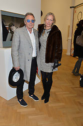 TIM SPICER and PAULINE AMOS at the opening private view of 'A Strong Sweet Smell of Incense - A portrait of Robert Fraser, held at the Pace Gallery, Burlington Gardens, London on 5th February 2015.