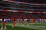 Atlanta Falcons cheerleaders during the national anthem.