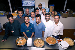 Group of men and the food they have prepared in celebration of Navratri; the Hindu festival of Nine Nights,