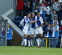 Photo: Peter Phillips.<br /> Blackburn Rovers v Fulham. The Barclays Premiership.<br /> 20/08/2005.<br /> Morten Gamst Pedersen is congratulated by Neill and Reid after giving Rovers the lead in the 15th minute