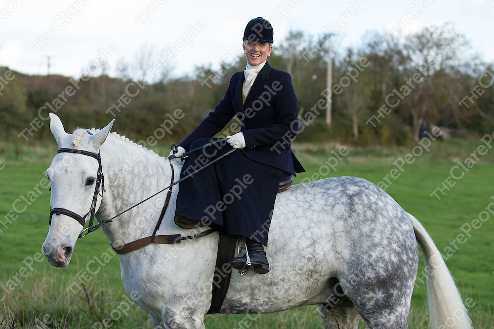 Whipper in Gillian Byrnes riding sidesadle in the 2015 Quin Hunt