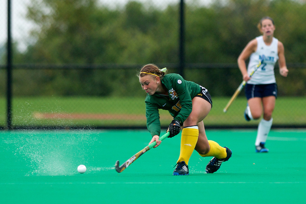 Catamounts midfielder Aria Robinson (15) hits the ball during the women's field hockey game between the Maine Black Bears and the Vermont Catamounts at Moulton/Winder Field on Saturday afternoon September 29, 2012 in Burlington, Vermont.