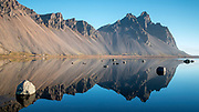 Reflections of Vestrahorn on a clear autumn day at Stokksnes, south-east Iceland