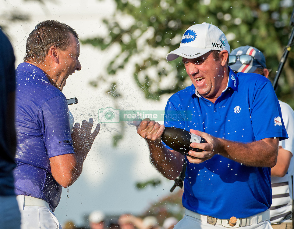 December 11, 2016 - Hong Kong, Hong Kong S.A.R, China - Final round of the 58th Hong Kong Open at The Hong Kong Golf Club Fanling, Hong Kong, Hong Kong SAR, China. Sam Brazel takes the trophy by one stroke with a birdie on the 18th. Brazel celebrates his win on the 18th with a spray of champagne from fellow Australian player Scott Hend  (Credit Image: © Jayne Russell via ZUMA Wire)