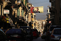 A poster of slain Lebanese journalist Gebran Tueni hangs over the street in the Gemmayze neighborhood in Beirut, Lebanon, March 30, 2006. Tueni was killed by a car bomb at the same time as the release of the second progress report of a United Nations inquiry into Syria's involvement in the assassination of former Lebanese Prime Minister Rafik Hariri.