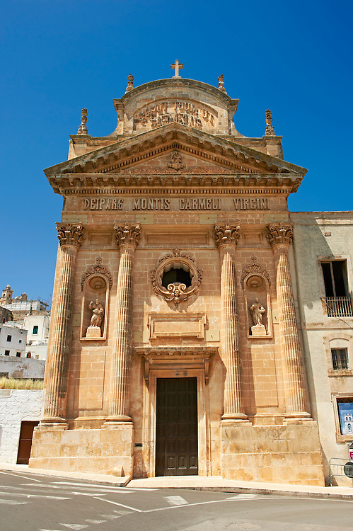 The 19th century Neo Classic facade of the Carmine Church ( Chisea sel Carmine )   .Ostuni, The White Town, Puglia, Italy. .<br /> <br /> Visit our ITALY HISTORIC PLACES PHOTO COLLECTION for more   photos of Italy to download or buy as prints https://funkystock.photoshelter.com/gallery-collection/2b-Pictures-Images-of-Italy-Photos-of-Italian-Historic-Landmark-Sites/C0000qxA2zGFjd_k<br /> .<br /> <br /> Visit our MEDIEVAL PHOTO COLLECTIONS for more   photos  to download or buy as prints https://funkystock.photoshelter.com/gallery-collection/Medieval-Middle-Ages-Historic-Places-Arcaeological-Sites-Pictures-Images-of/C0000B5ZA54_WD0s