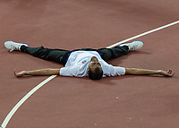 Athletics - 2017 IAAF London World Athletics Championships - Day Ten, Evening Session<br /> <br /> Mens High Jump Final <br /> <br /> Majd Eddin Ghazal (Syria) Lays out flat on the track after securing the bronze medal at the London Stadium<br /> <br /> COLORSPORT/DANIEL BEARHAM