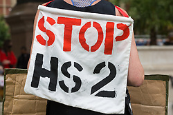 An activist wears a Stop HS2 sign at a Kill The Bill protest in Parliament Square against the Police, Crime, Sentencing and Courts (PCSC) Bill 2021 as MPs consider amendments to the Bill in the House of Commons on 5th July 2021 in London, United Kingdom. The PCSC Bill would grant the police a range of new discretionary powers to shut down protests, including the ability to impose conditions on any protest deemed to be disruptive to the local community, wider stop and search powers and sentences of up to 10 years in prison for damaging memorials.