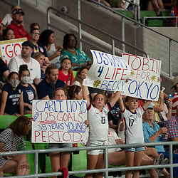 Young fans hold signs of support for Team USA as the US Women's National Team (USWNT) beats Nigeria, 2-0 in the inaugural match of Austin's new Q2 Stadium. The U.S. women's team, an Olympic favorite, is wrapping up a series of summer matches to prep for the Tokyo Games.