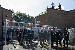 London, UK. 23 September, 2015. Housing activists take refuge from bailiffs on a roof on the Sweets Way housing estate. A group of housing activists calling for better social housing provision in London occupied properties on the 142-home estate in Whetstone, in a few cases refurbishing properties intentionally destroyed by the legal owners following eviction of the original residents, in order to try to prevent the eviction of the last resident on the estate and the planned demolition and redevelopment of the entire estate by Barnet Council and Annington Property Ltd.