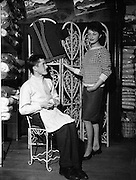 Handmade Sweater and Knitter at Donegal Shop..1961..12.12.1961..12th December 1961..Image taken at the Donegal Shop in the Creation Arcade, Grafton Street where a display of hand knitting was held. The garments were also modelled for the attending media.