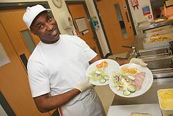 Kitchen staff preparing food for Centre.