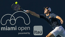 March 25, 2019 - Miami Gardens, FL, USA - Reilly Opelka, of the United States, returns a shot to Daniil Medvedev, of Russia, during their match at the Miami Open tennis tournament on Monday, March 25, 2019 at Hard Rock Stadium in Miami Gardens, Fla. (Credit Image: © Matias J. Ocner/Miami Herald/TNS via ZUMA Wire)