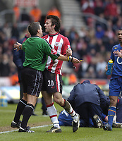 Photo: Alan Crowhurst, Digitalsport<br /> Southampton v Arsenal, 26/02/2005, Barclays Premiership. David Prutton is held back by referee Alan Whiley as he tries to get to the linesman .  sending