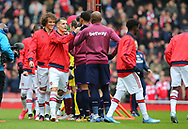 Arsenal's Granit Xhaka fist bumps West Ham's Angelo Ogbonna before the Premier League match at the Emirates Stadium, London. Picture date: 7th March 2020. Picture credit should read: Paul Terry/Sportimage