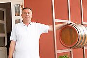 Zoran Vukoje the owner and winemaker outside the winery. Vukoje winery, Trebinje. Republika Srpska. Bosnia Herzegovina, Europe.