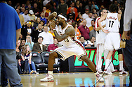 LeBron James pretends to take a picture of his teammates in what has become one of his may pregame rituals before a win over visiting New Jersey on March 25, 2009 at Quicken Loans Arena. The victory set a new Cavaliers record for wins in a season at 58.