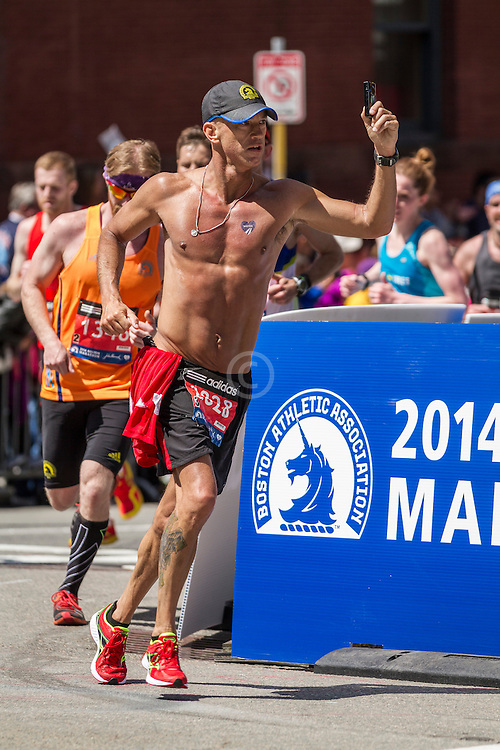 2014 Boston Marathon: runner take a selfie as he heads for the finish line