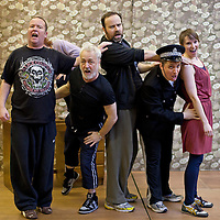 """Picture shows : Paul Riley as Fran,, Jimmy Chisolm as Simon (back), Greg Hemphill as Finlay, Johnny McKnight as Callum (policeman) and Ros Sydney as Morag..Rehearsal of the forthcoming National Theatre of Scotland production 'An Appointment with The Wicker Man'..Picture © Drew Farrell  ( Tel : 07721-735041 ).On a remote Scottish island, the Loch Parry Theatre Players mount their am-dram version of The Wicker Man. When their lead actor goes missing in mysterious circumstances, they call on the services of a television cop from the mainland to step in and save their production. ..The play opens at the MacRobert Arts Centre, Stirling on 18th February 2012 before touring Aberdeen, Glasgow, Inverness and Dunfermline...The Wicker Man regularly tops """"Best Horror Film of All Time"""" lists and is regarded as a true film classic. With an unforgettable sense of creeping dread, a wonderfully memorable score by Paul Giovanni, career defining performances from Edward Woodward and Christopher Lee it also has arguably the best ending in cinema history. Now, in an affectionate new adaptation, the National Theatre of Scotland gives a gallus round of applause to this immortal chronicle of strange goings-on in a wee village. ..An Appointment with the Wicker Man features Greg Hemphill (Chewin' the Fat) and Johnny McKnight (Little Johnny's Big Gay Wedding) alongside a line-up of comic talent. It is at once a deliciously wicked homage to, and a tender celebration of, a piece of cinema history that reveals for us the spooky undercurrents lurking just below the surface of Scottish village life. ..The Loch Parry Players are messing with forces they can't possibly comprehend but at the end of the night, only one thing is for sure . . . someone's going to burn for this...Cast..Sean Biggerstaff    as       Howie and Rory.Jimmy Chisolm      as       Simon.Greg Hemphill        as     Finlay.Johnny McKnight   as      Callum.Sally Reid                 as      Marie.Paul Riley."""