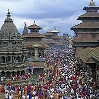 NEPAL, Kathmandu Valley. Hindus celebrate Krishna's Birthday (Krishna Asthami) at at temples and pagodas in Durbar Square in Patan.