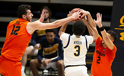 Feb 25, 2021; Berkeley, California, USA; Oregon State Beavers defenders Roman Silva (12) and Jarod Lucas (2) block a shot by California Golden Bears guard Jarred Hyder (3) during the second half of an NCAA college basketball game at Haas Pavilion. Mandatory Credit: D. Ross Cameron-USA TODAY Sports