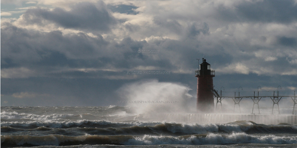 Large waves crashing against the the lighthouse and pier in South Haven, Michigan